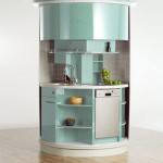 Circled kitchens table in compact concepts kitchen is highly functional