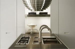 Contemporary kitchen equipped by high glos storage cupboard contrast with matt island in linear