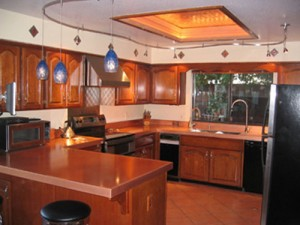 Copper Countertops and pans hanging racks from Frigo Design make your kitchen different