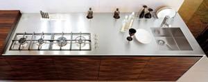 Ebony kitchen with geometric shape dominates uses grained wood stretches