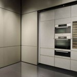 Giorgio Armani Calyx kitchens with long modern lines and bold flat accent