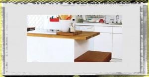 Kitchen with White Kitchen Island and Kichen Cabinet in Bright Apartment Pop Art apartment kitchen islands