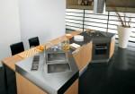 Modern Omnia kitchens use natural oak or grey oak furniture by Bontempi