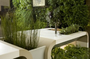 Outdoors Kitchen surrounded by trees and under an open sky Electrolux