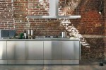 Stainles Steel Kitchen Cabinets with no handle door by Mark Elam Zanuso