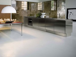 Stainless Steel Kitchen Cabinets with no handle door by Mark Elam Zanuso