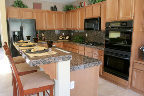 Two levels slab of granite in black and brown colors two for Black and brown kitchen ideas