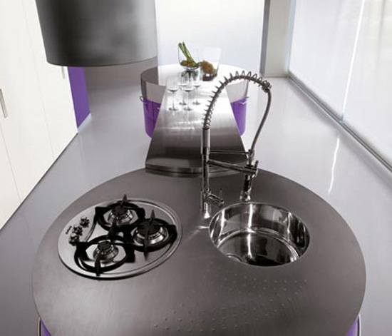 Ultra modern purple kitchen with cylindrical fan above stovetop