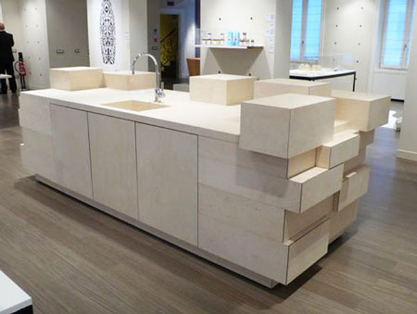 Unique drawer kitchen design gives a sculptural form to the growing demand space