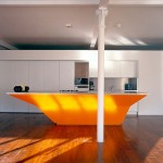 Unusual bright orange Kitchen Island combination of old and new traditions by A-EM Architects