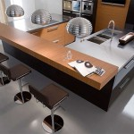 Urban Kitchen Designs stainless steel double sink connected to the worktops from Copat