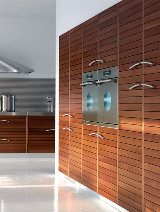 Walnut kitchen slats with black fillets give strong unit linear look
