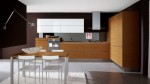 White Kitchens with Woodens Elements in Oyster by Veneta Cucine