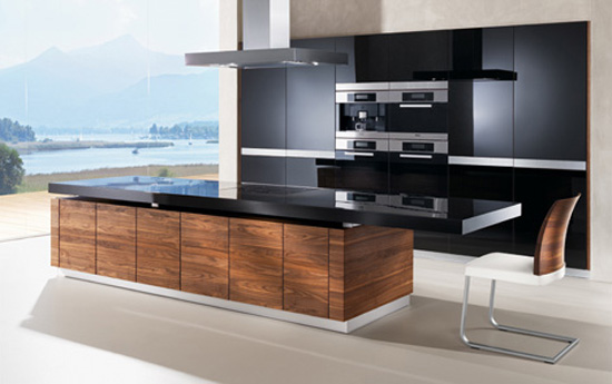 automated kitchen island with height adjustable worktop creates cocktail bar atmosphere