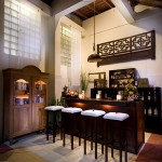 balinese kitchen pantry with antique style lamps hang and wood furniture ethnic