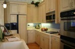 cheap kitchen design ideas by repainting kitchen cabinet and kitchen wall