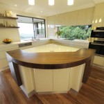 Contemporary kitchen design dominated by bright wood color