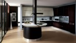 contemporary kitchen expanses drawn of bold color topped with smooth stainless steel