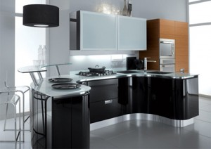 gleaming and glamorous kitchens with fluid sweeping workspaces by Fiamberti