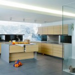 kitchen design with thick worktop top cupboard and natural panels in light or dark finishes