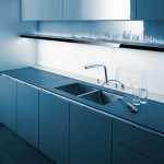 kitchen design with thick worktop top cupboard and natural panels in light or darkfinishes