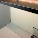 kitchen design with thick worktop top cupboard andnatural panels in light or dark finishes