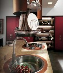 kitchen designer for Scavolini use light oak as kitchens table and chairs