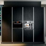 kitchendesign with thick worktop top cupboard and natural panels in light or dark finishes
