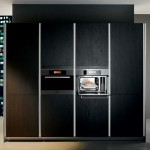 kitchens entertainment system with flat screen TV and hi-fi and natural panels in light or dark finishes 10.04.10