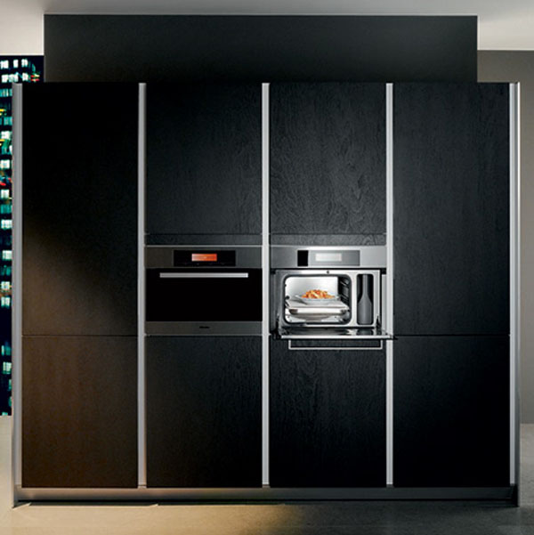 kitchens entertainment system with flat screen TV and hi-fi and natural panels in light or dark finishes