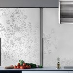 massive paneled wall unit Urban Kitchens from Bazzeo New Gaia covered with a light organic pattern