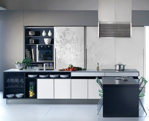 massive paneled wall units Urban Kitchens from Bazzeo New Gaia covered with a light organic pattern