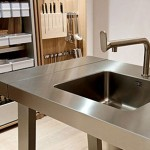 minimal kitchen island design simple and sleek look with art inspired faucets