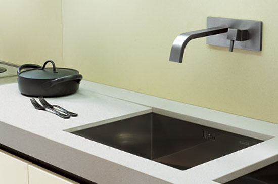 minimalist kitchen with fabulous geometric sink featuring stunningly stark faucets
