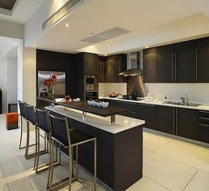 modern kitchen with black cabinets to store bottles or can