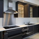 modern kitchen with black cabinets to store bottles or cans