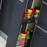 modern kitchens with black cabinet to store bottles or cans