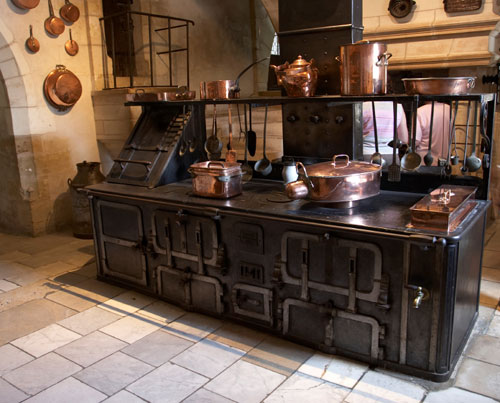 natural building materials of a traditional turn of the century French country kitchen