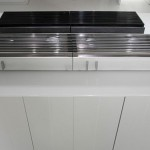 natural lava stone, wood steel and aluminium achieves geometrical harmony Italian white kitchen design