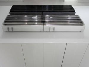 natural lava stone, wood steel and aluminium achieves geometrical harmony Italian white kitchen design