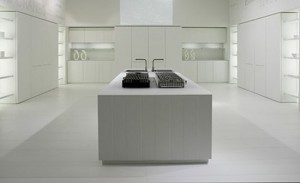natural lava stone, wood, steel and aluminium achieves geometrical harmony Italian white kitchen design