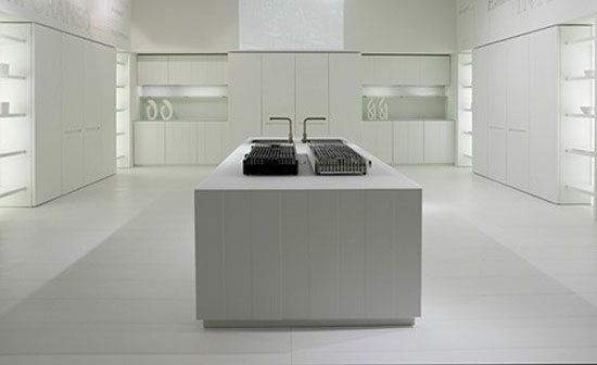 natural lava stone, wood, steel and aluminium achieves geometrical harmony Italian white kitchen design