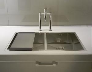 neutral tone kitchen Contrasting glossy white and matt black pantry from Salvarani