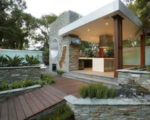 outdoor kitchen or open air kitchen linked with pool and garden