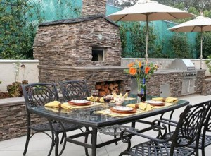 outdoor kitchens or open air kitchen linked with pool and garden