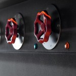 red-colored knobs of timeless classic style of kitchen design with black metal
