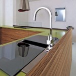 simply slide tempered glass backsplash in green corian Zen like design by Toffini