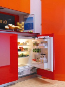 small kitchen in little apartment gives living space for yourng girls