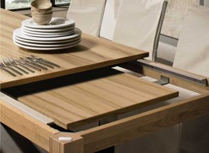 Unusual dining table with wood and stainless steel