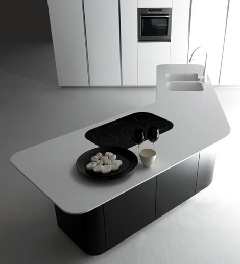 white countertops contrast to the dark wood cabinetry is quite refreshing design